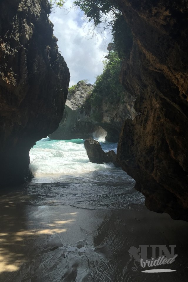 Hidden beaches in Bali: narrow rock cove with strong waves