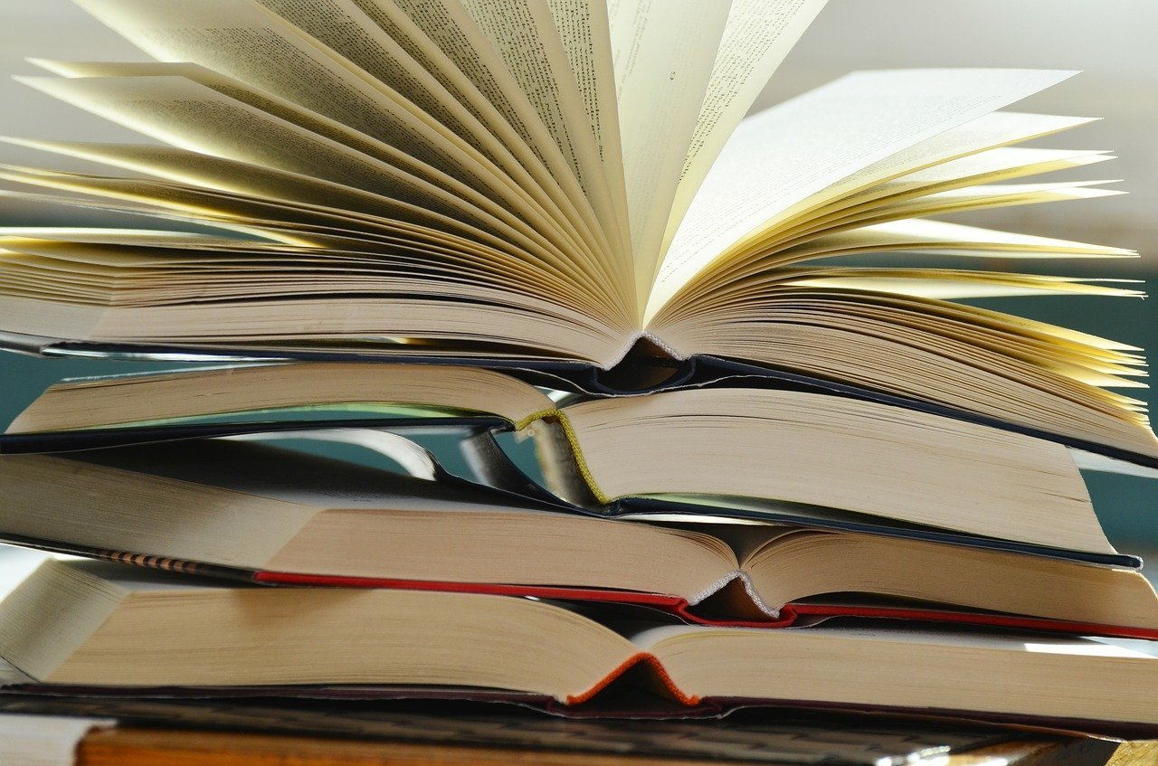 drop out or graduate: books piled up