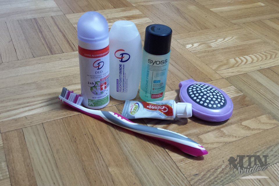 Only necessary beauty products in case of lost baggage: toothbrush, toothpaste, hair brush, shampoo, shower gel, deodorant