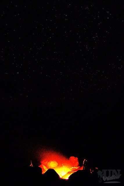 Stars and fire at a beach on Kauai