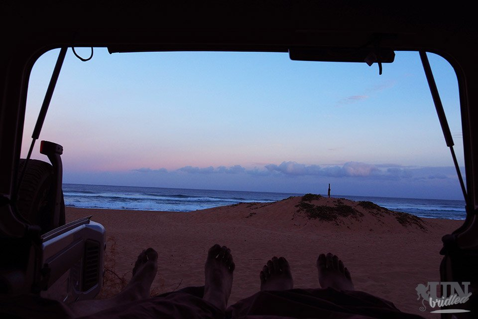 Traveling Kauai on budget has benefits: View from the car onto the ocean and beach at sunrise