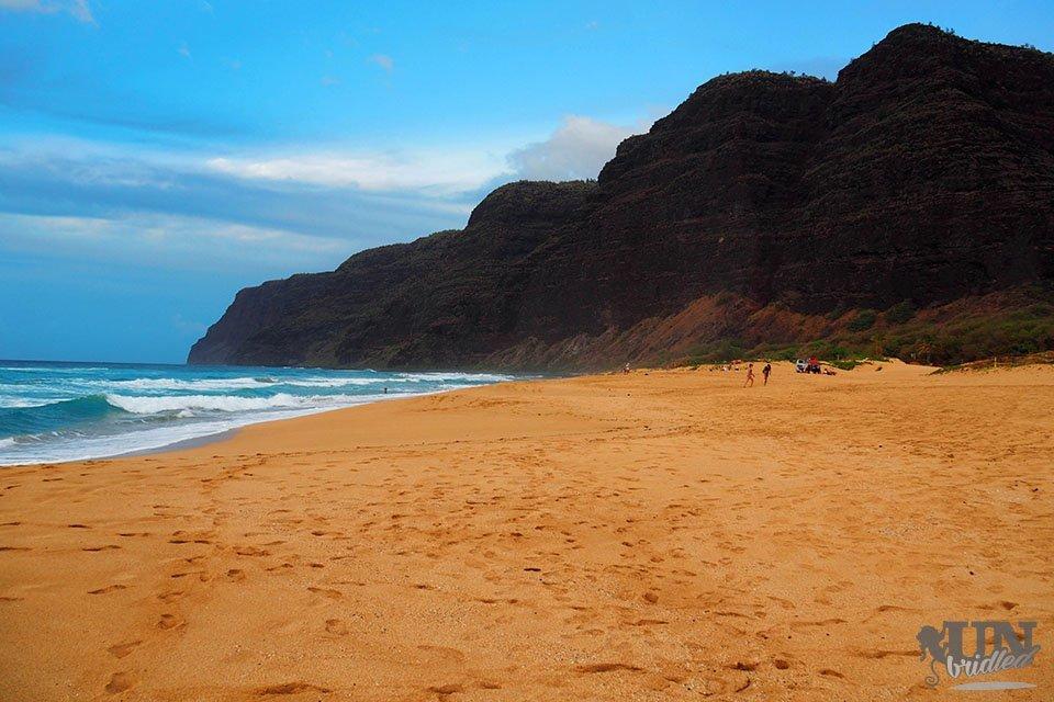 Polehale beach in Kauai - wide beach, blue water and mountains