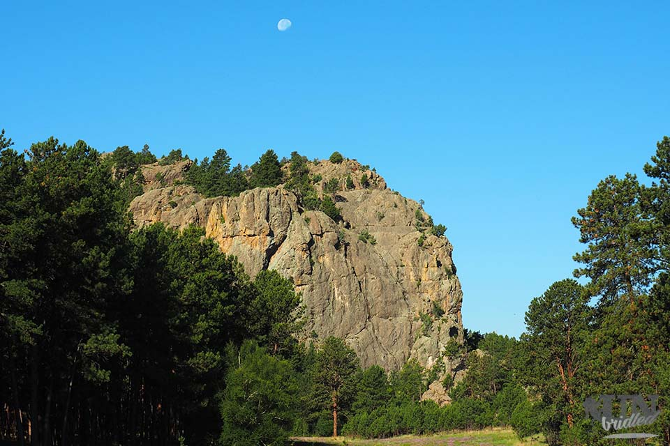 The moon above a mountain at daylight