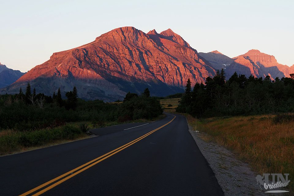 Wide empty street with mountains in the background at sunrise