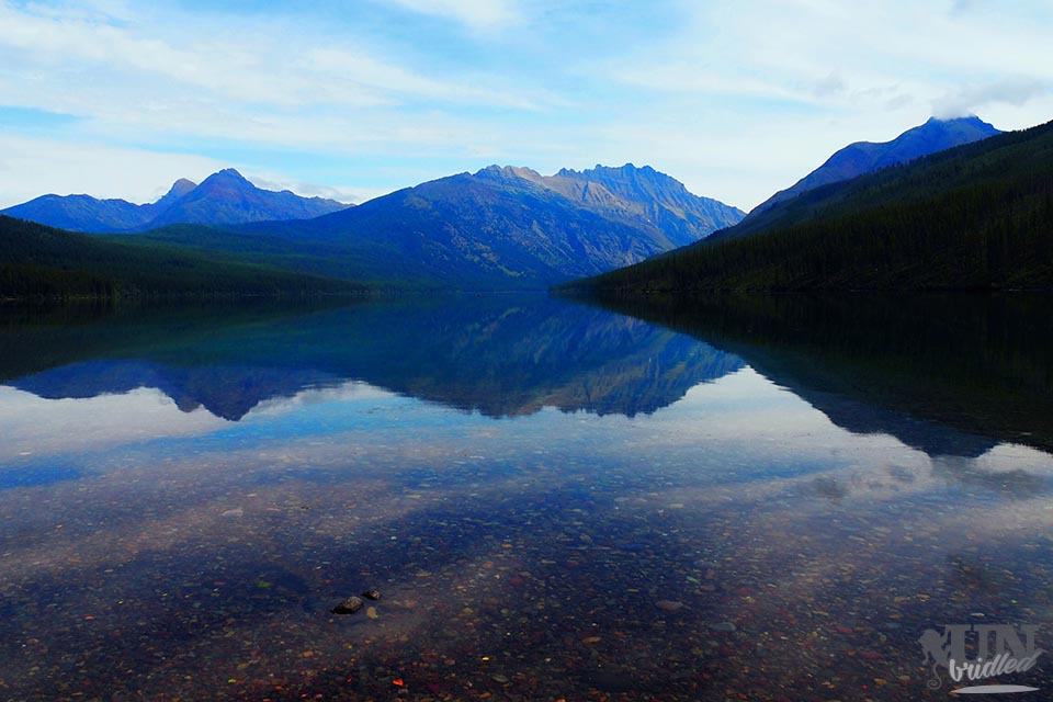 Colorful pebbles, tranquility, crystal clear water & mountains: Kintla Lake at Glacier National Park