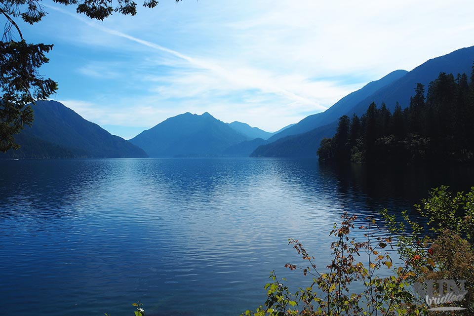 View of a big blue lake with mountains surrounding the lake in Olympic National Park