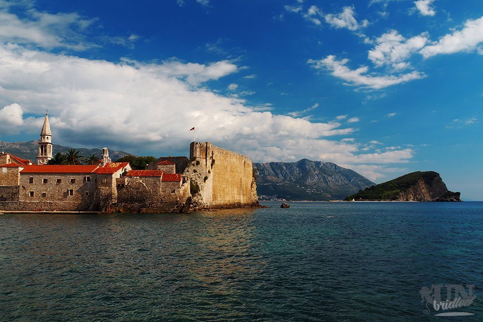 Outside view of Budva's old town with the mountains in the background