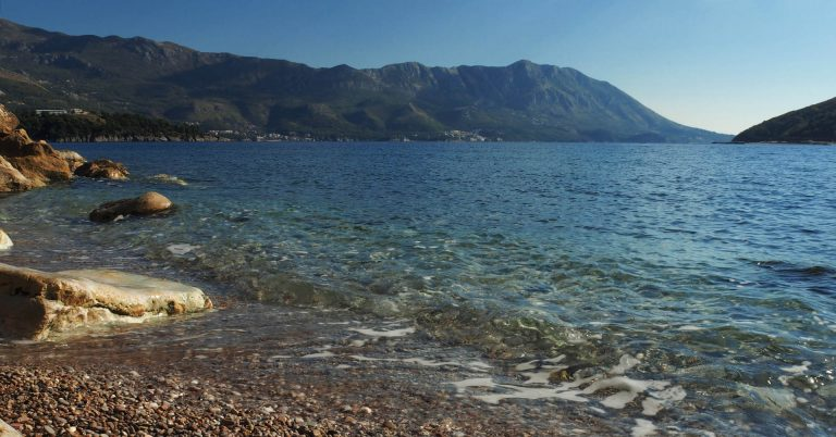 Pebble beach in Montenegro with crystal-clear water