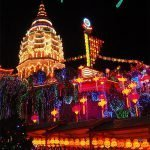 Temple with a lot of lights and the text: Chinese New Year in Penang