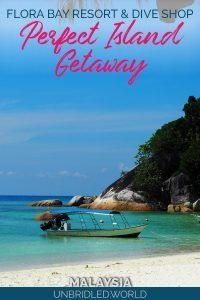Beach scene with a boat and the text: Flora Bay Resort & Dive Shop - Perfect Island Getaway