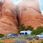 Travel trailers and vehicles in front of orange rocks with the text: 20 Most scenic campsites