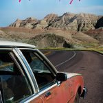 Old Station Wagon in front of a mountain scenery with the text: It's time to plan your next road trip