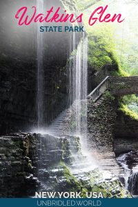 Waterfall with a bridge in the background and the text: Watkins Glen State Park