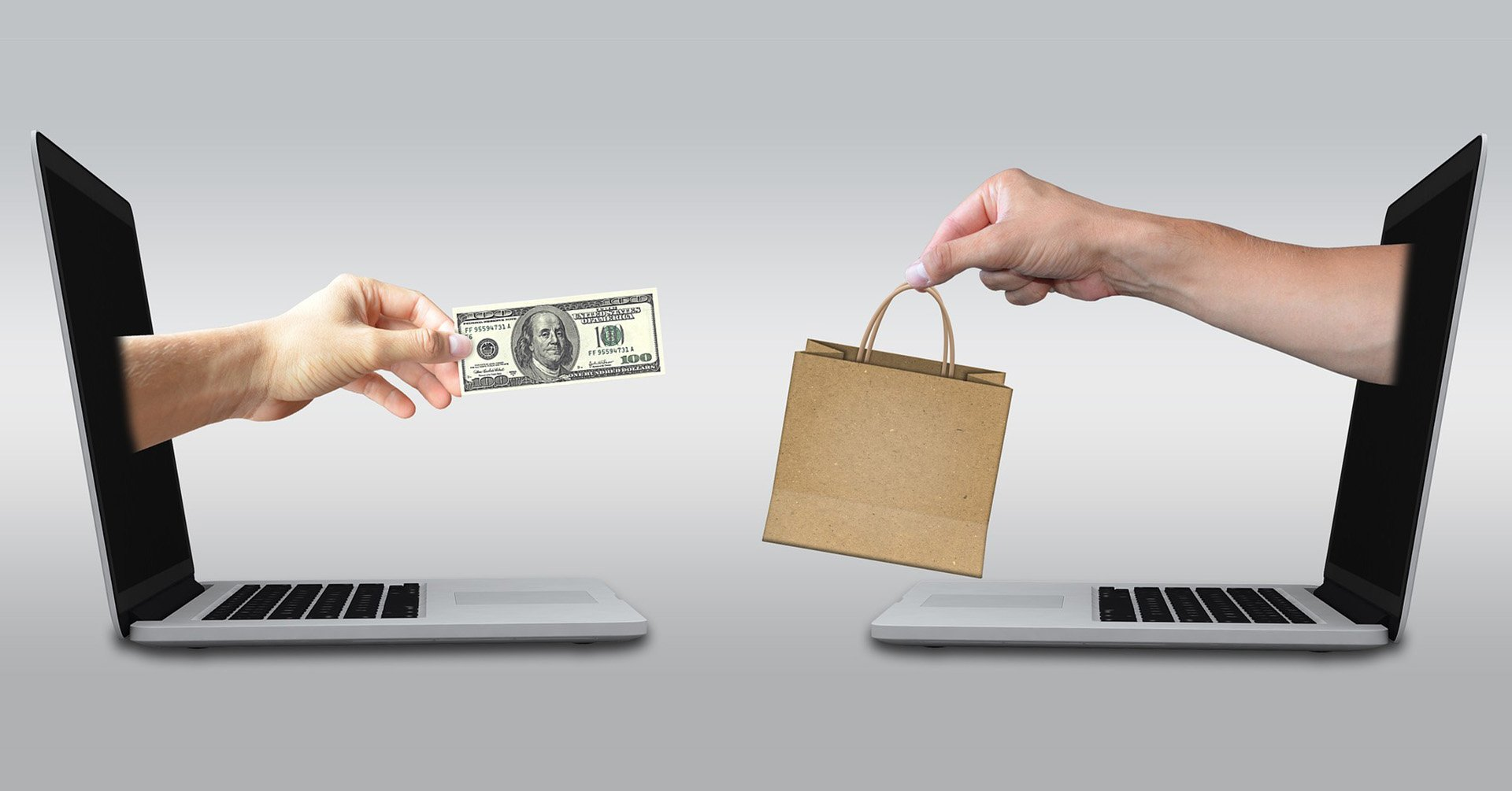 Two laptops that have arms coming out of the screens. The hands hold money (left) and a shopping bag (right).