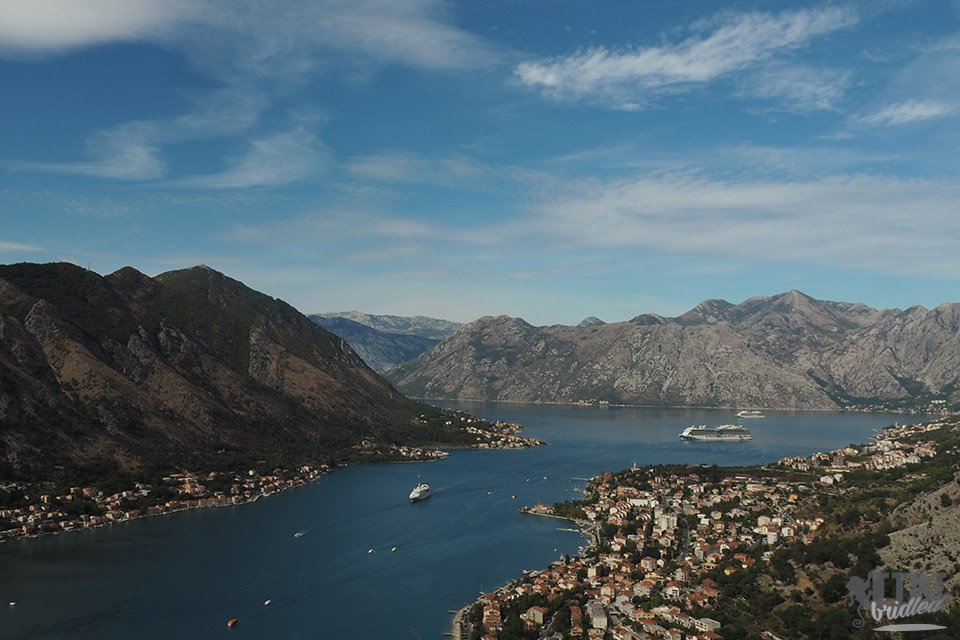 View of Bay of Kotor from above, with mountains framing the whole bay