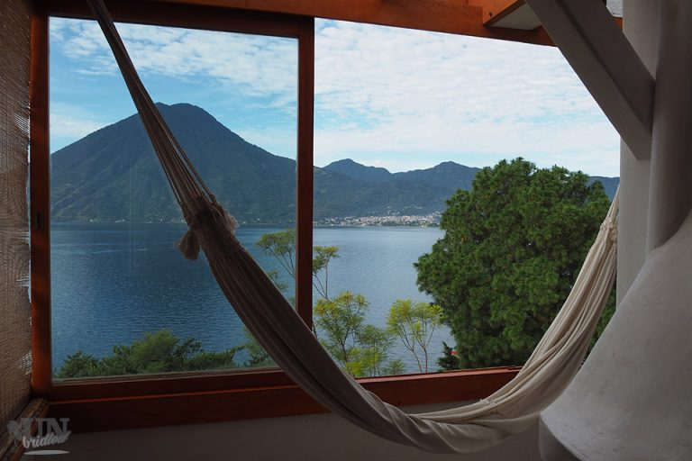 Hammock in front of a window, which provides a scenic view of Lake Atitlan in Guatemala