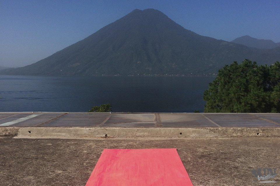 Red yoga mat with the view of Lake Atitlan