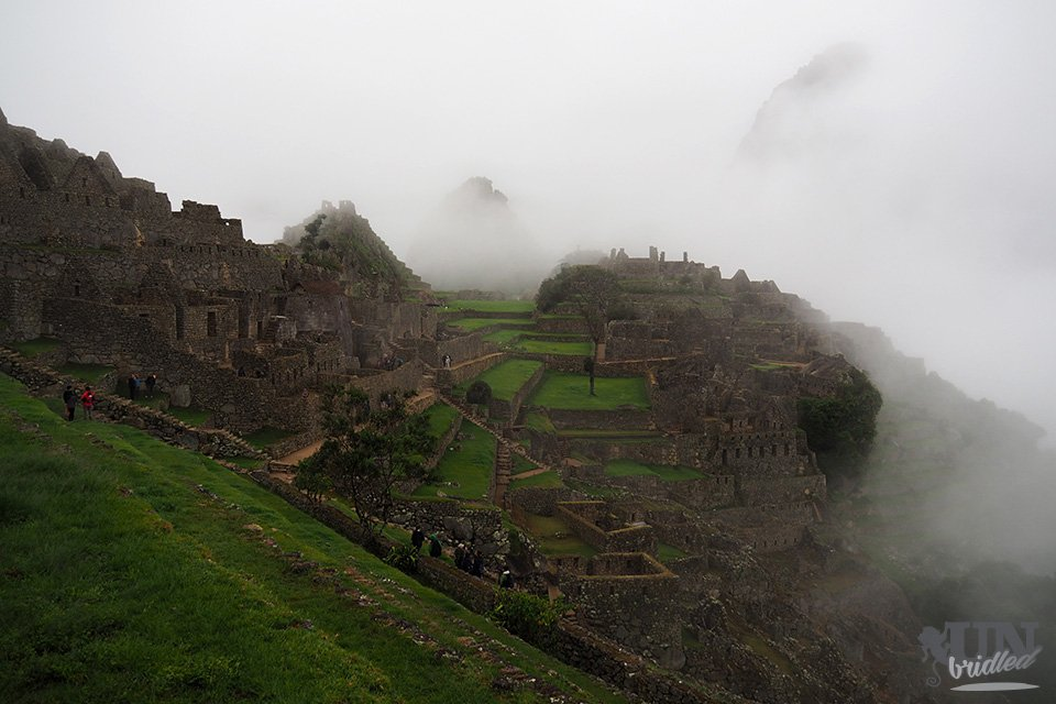 Barely visible Inca ruins at Machu Picchu