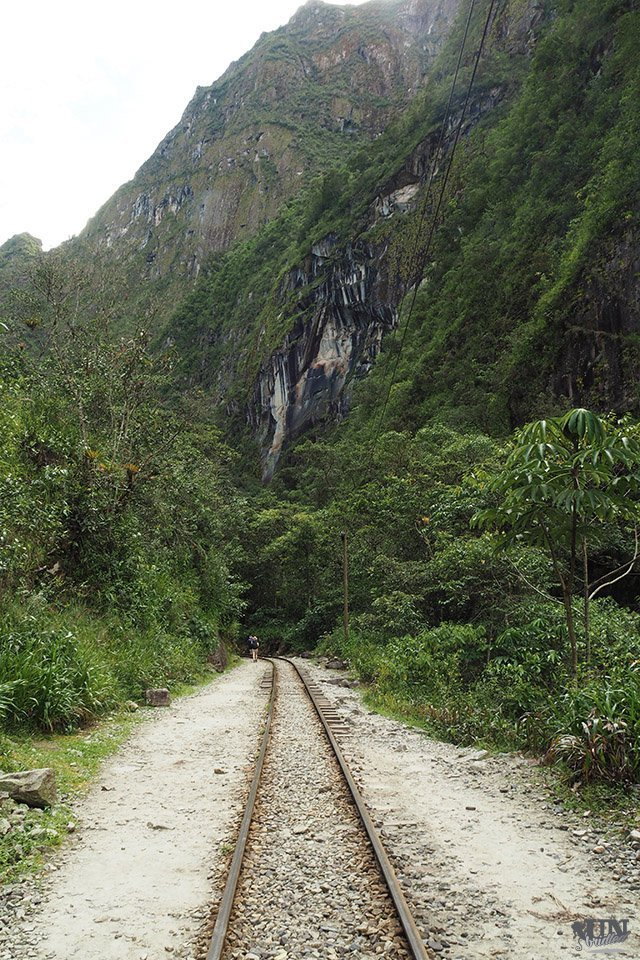 Train tracks passing the mountains near Machu Picchu
