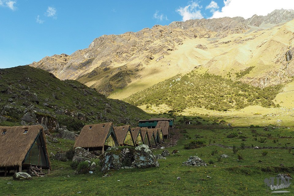 Little mountain huts on a campsite along the Salkantay Trek