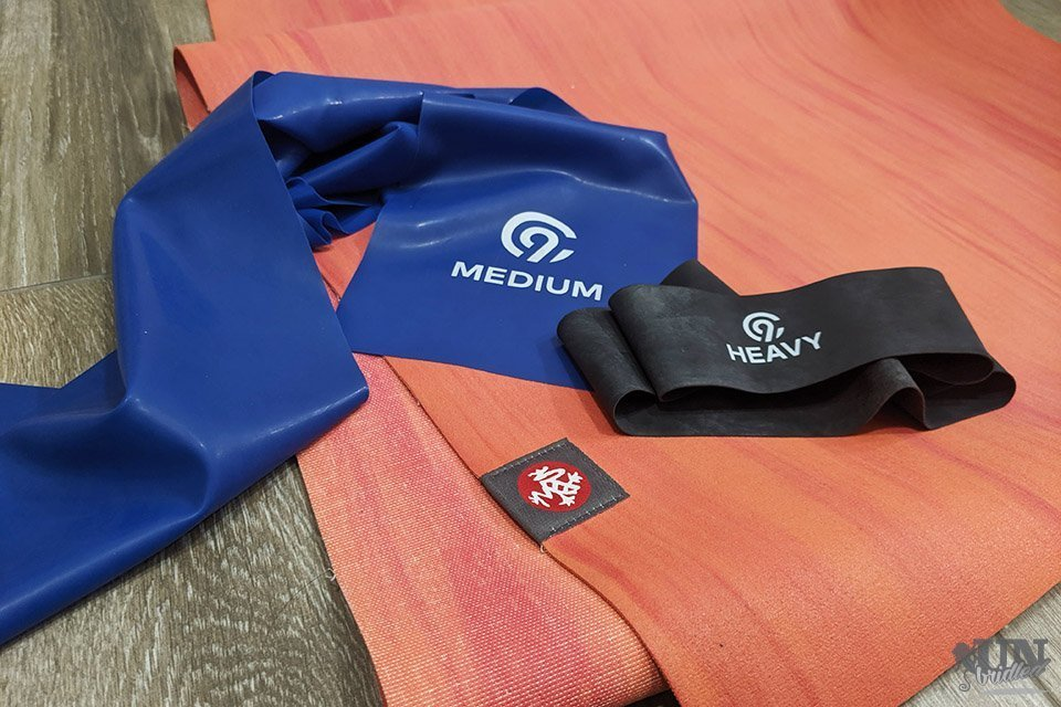 Thin Manduka yoga mat and resistance bands
