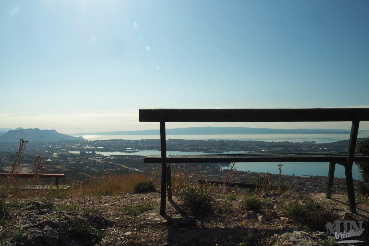 Bench in front of a beautiful scenery showing Split in Croatia