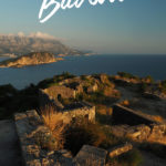 Sunset view of Budva bay with the text: Hiking Trails around Budva