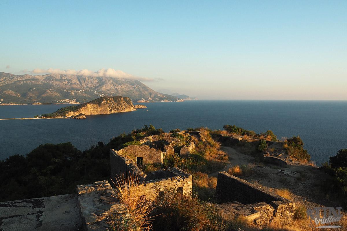 Fortress ruins at sunset overlooking Budva Bay