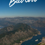 View of a bay with mountains and the text: Hiking Trips from Budva